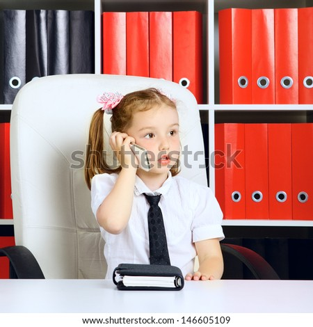 little girl as a businesswoman, in office - stock photo