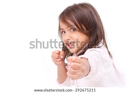 little girl assuming stance, practicing martial arts, self-defense, kungfu, karate, boxing - stock photo