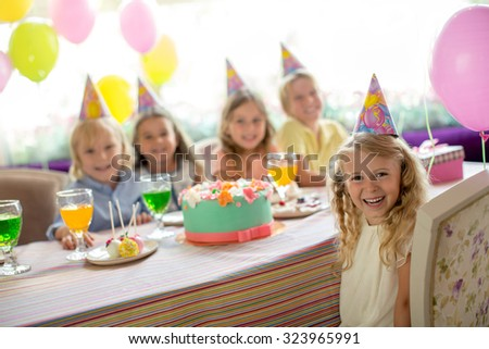 Little girl at a birthday party at home