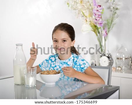 little girl at breakfast time - stock photo