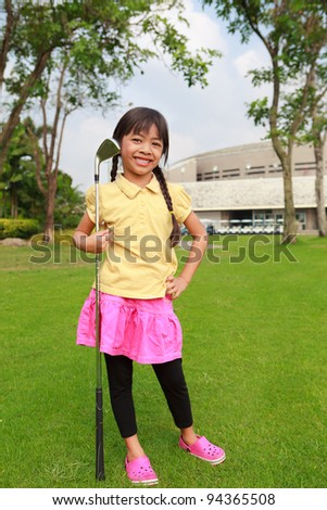 Little girl at golf club - stock photo