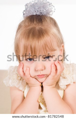 little girl at sofa on a white - stock photo