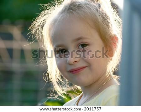 Little girl at the corner - stock photo