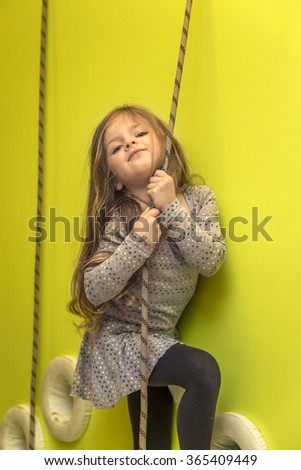 Little girl at the playground - stock photo