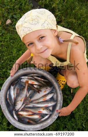 Little girl at tower with perch - stock photo