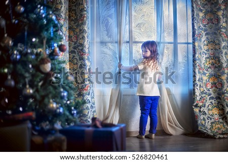 Little girl awaiting Santa Claus