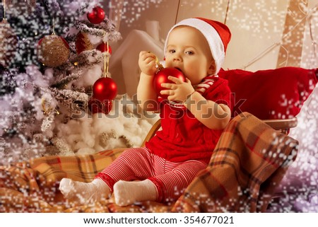 Little girl, baby in Christmas interior. Toned photo with decoration frame, retro instagram. Winter holidays concept. Copy space. Merry Christmas and Happy New Year! - stock photo