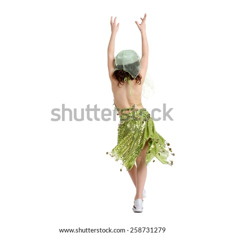 little girl back dancing in the costume of the eastern beauty - stock photo
