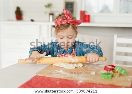 little girl baking cookies - stock photo