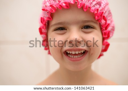 Little girl bathing - stock photo