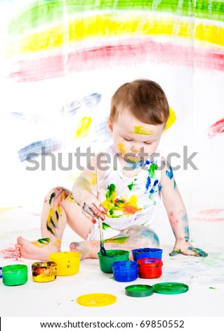 little girl bedaubed with bright colors