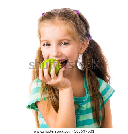 little girl biting an apple isolated on white background - stock photo