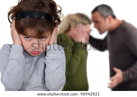 Little girl blocking out her parents' argument - stock photo