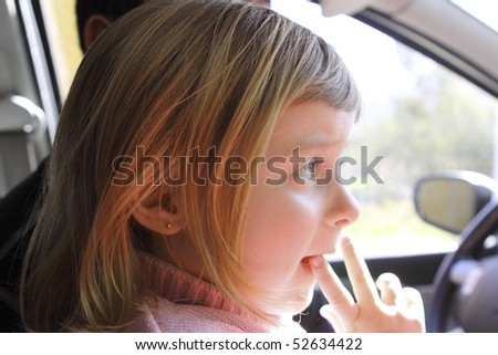 little girl blond profile car vehicle interior portrait - stock photo