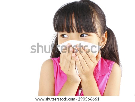 Little girl blows her nose - stock photo