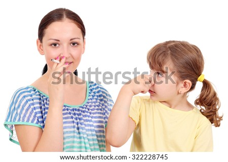 little girl bothered by tobacco smoke