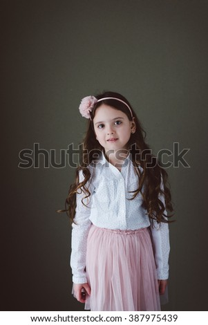 Little girl brunette posing