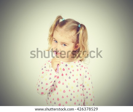 Little girl brushing her teeth. Girl with a toothbrush. Oral hygiene. - stock photo