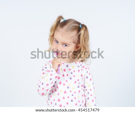 Little girl brushing her teeth. Girl with a toothbrush. Oral hygiene.