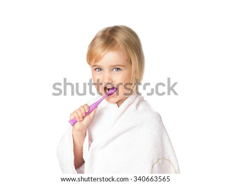 Little girl brushing her teeth. Isolated on a white background. - stock photo