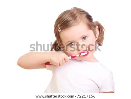 Little girl brushing her teeth isolated on white background - stock photo