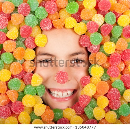 little girl buried on colored jellybeans