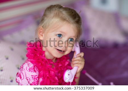 little girl calling on her cell phone
