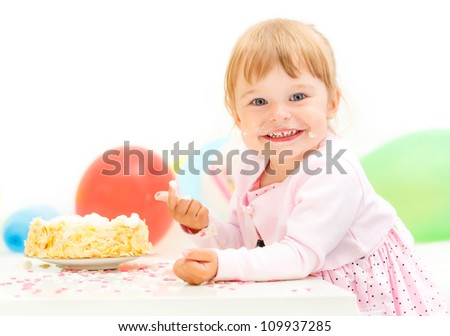 Little girl celebrating here second birthday - stock photo