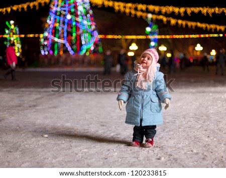 little girl celebrating New Year around the Christmas tree - stock photo