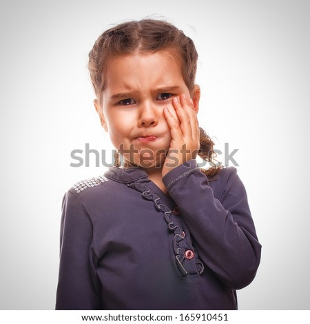 little girl child have toothache, toothache emotions large inflated cheek emotion background - stock photo