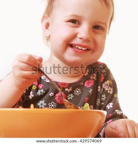 Little girl child wants to eat (children's food, bio, health) - stock photo