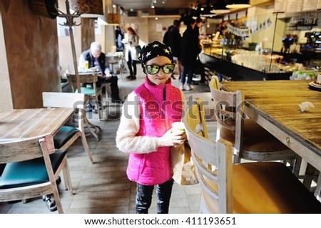 Little girl choosing bread in a food bakery store - stock photo