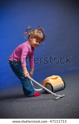 little girl cleaning carpet - stock photo