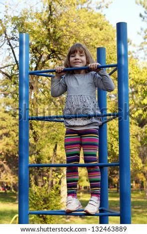 little girl climb on park playground - stock photo