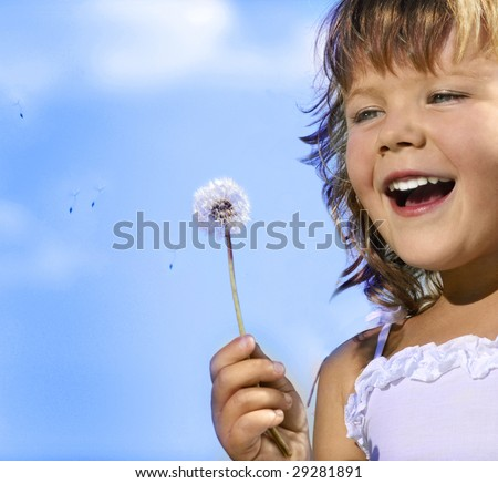 little girl closeup portrait with dandelion - stock photo