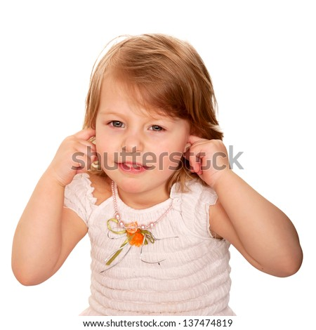 Little girl closing ears with fingers. Isolated on white background - stock photo