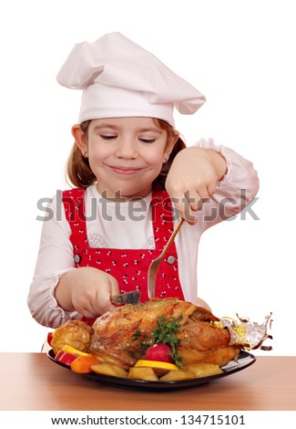 little girl cook eat roasted chicken - stock photo