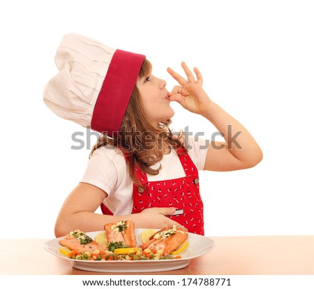 little girl cook with ok hand sign and salmon on dish - stock photo