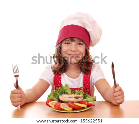 little girl cook with salmon seafood on table - stock photo