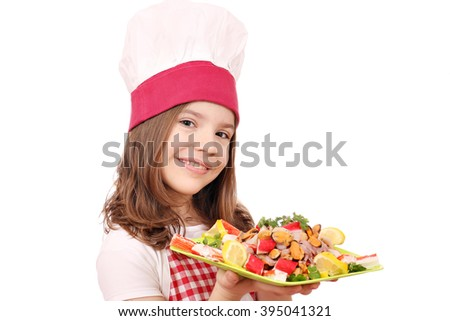 little girl cook with seafood - stock photo