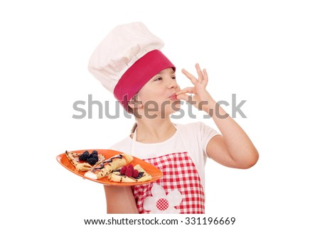 little girl cook with sweet crepes and ok hand sign - stock photo