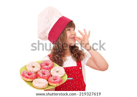 little girl cook with sweet donuts and ok hand sign - stock photo
