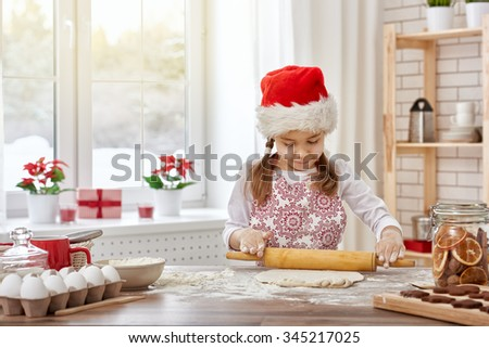little girl cooking Christmas biscuits - stock photo