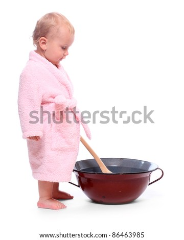 LIttle girl cooking i the big pot.