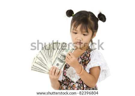 little girl counting us dollars, isolated on white background - stock photo