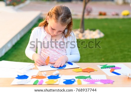 Little girl create greeting card image stock photo royalty free little girl create greeting card image stock photo royalty free 768937744 shutterstock m4hsunfo