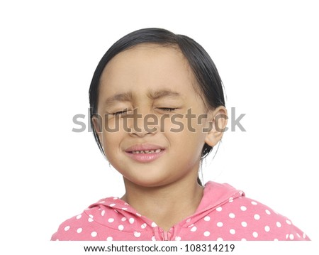 Little girl crying with tears rolling down her cheeks, - stock photo