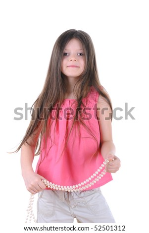Little girl dancing with a strand of white pearls in her hand. Isolated on white background