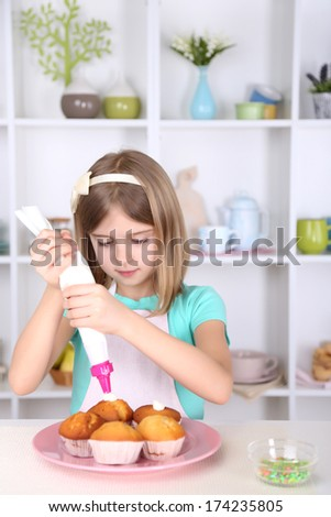 Woman Decorating Cupcakes simple woman decorating cupcakes stock photo with ideas