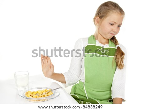 little girl did not want to eat cereal and milk - stock photo